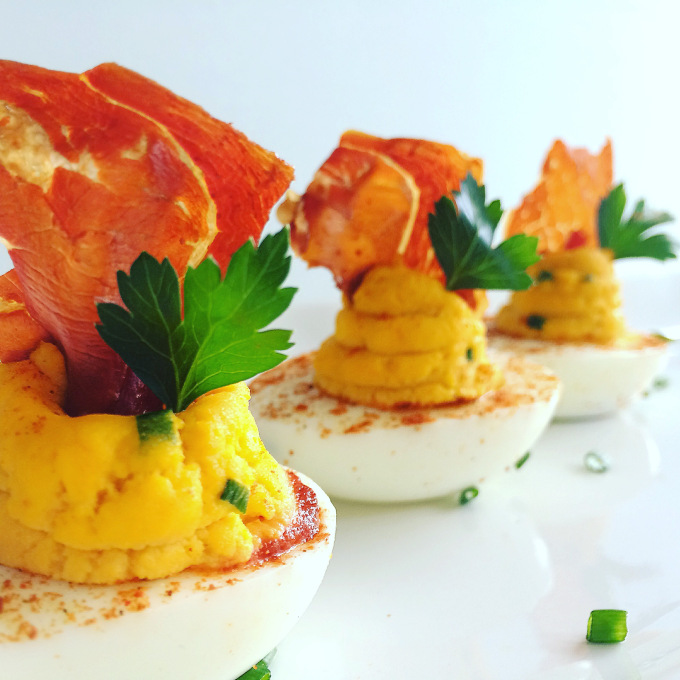 SRIRACHA DEVILED EGGS WITH CRISPY SERRANO HAM